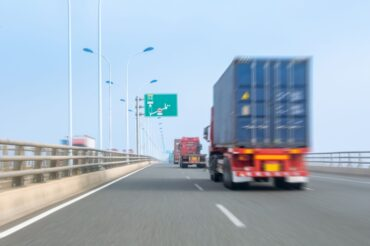 container-trucks-on-bay-bridge-P7QKEA3 (1)