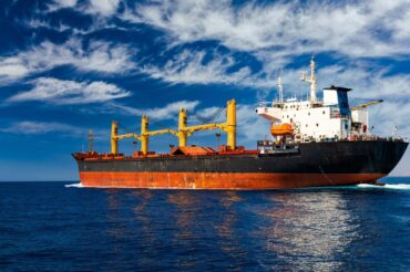 cargo-ship-at-sea-against-the-blue-sky-logistics-a-6SU6NNJ-compressed